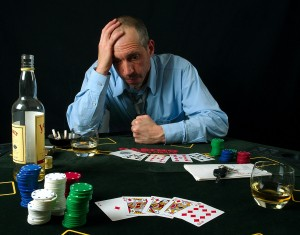 man losing at poker